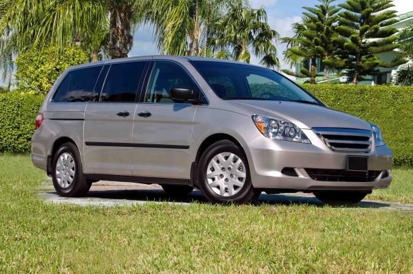 Family Van - front-right shot of a silver minivan