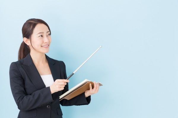 portrait of asian businesswoman on blue background